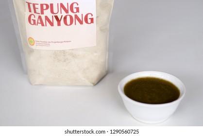 Depok, Indonesia - January 19, 2019: Canna edulis Ker. or ganyong porridge (front) and Canna edulis Ker. flour (behind).  Healthy food.