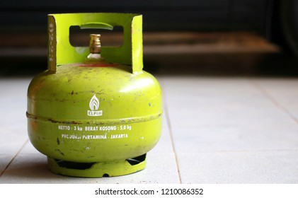 Depok, Indonesia - October 23, 2018: Subsidized 3-kilogram liquefied petroleum gas (LPG) canisters for low-income households in Indonesia. Editorial illustrative.