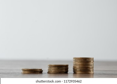 Deposit, coins on the table are laid out in stairs. The concept of bank and investment deposit, interest, money growth, bank deposit. Credit for business.