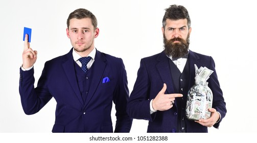 Deposit concept. Oldfashioned man prefers cash, modern guy recommends credit card, electronic money, internet banking. Men in suit, businessmen with jar full of cash and credit card, white background.