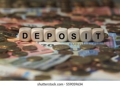 deposit - cube with letters, money sector terms - sign with wooden cubes