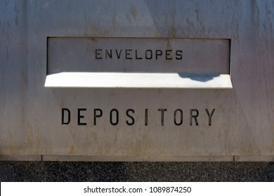 A depository waits to receive envelopes