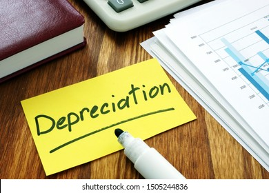 Depreciation concept. Stack of business papers.