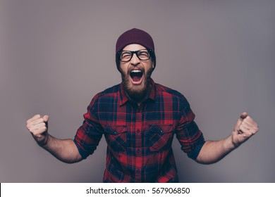 Depressed angry hipster bearded man yelling and screaming.