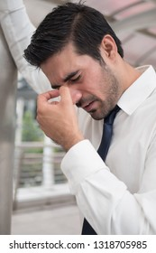 depressed asian business man; portrait of sick indian asian man with depression suffering from headache, vertigo, hangover, migraine, stress