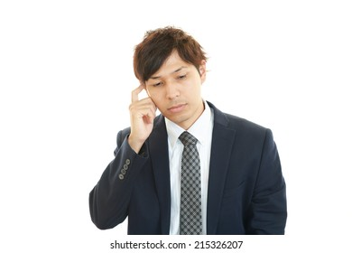 Depressed Asian businessman