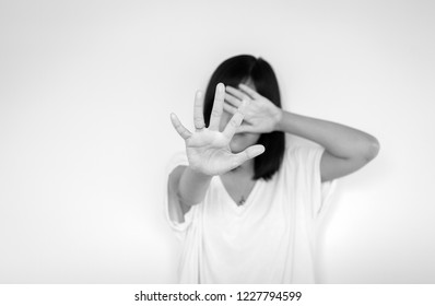 Depressed asian woman on white blackground,Hands stop harassment sexual abuse