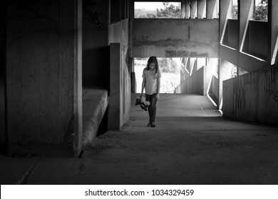 Depressed asian young girl walking alone in an abandoned building, Children with Behavioral and Emotional Disorders