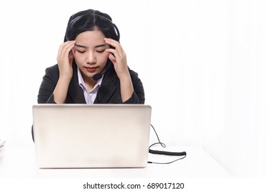 Depressed bored operator women of working call center services with headset at workplace. call center and customer service help desk concept. boring job concept