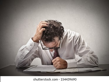 depressed businessman sitting at the office