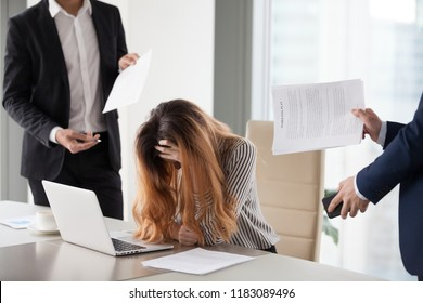 Depressed businesswoman feeling stressed bothered by male colleagues at work, female CEO suffer from headache or excessive workload annoyed by clients or subordinates, woman in despair manage anxiety