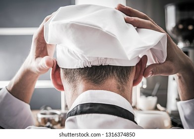 Depressed Caucasian Kitchen Chef. Cooking Went Wrong Food Preparation and Industry Concept. Toque Blanche.