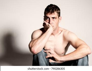 Depressed Caucasian male on white background