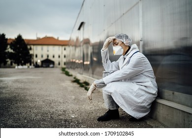 Depressed crying doctor with mask having mental breakdown.Fear,anxiety,panic attack due to coronavirus outbreak.Psychological effects of COVID-19.PTSD.Mental health,coping with death - Shutterstock ID 1709102845