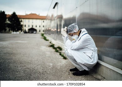 Depressed crying doctor with mask having mental breakdown.Fear,anxiety,panic attack due to coronavirus outbreak.Psychological effects of COVID-19.PTSD.Mental health,coping with death - Shutterstock ID 1709102854