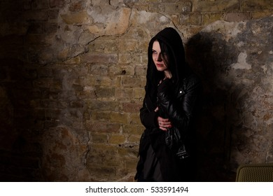 Depressed drug addict having disease or illness while standing near brick wall on street. Drug addiction concept. Unhealthy concept.