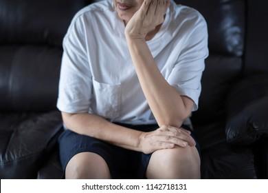 Depressed elderly woman sitting
