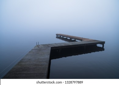 Depressed emotions concept: an empty jetty, on a foggy, winters morning.