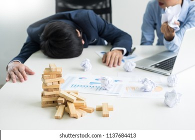 Depressed failure and tired businessman late sad and solving problem in office. in meeting room. stressed and worried at work crisis concept.