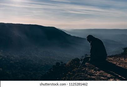 depressed and hopeless man alone.