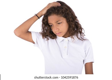 A depressed kid putting his hand on the head and looking down, isolated on a white background.