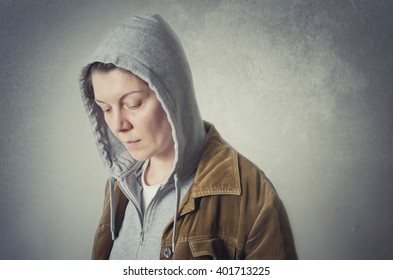 Depressed lonely person on gray wall background
