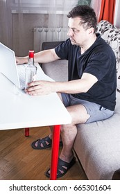 Depressed male sitting at his workplace