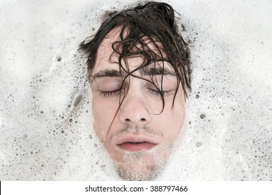 Depressed man in bathtub