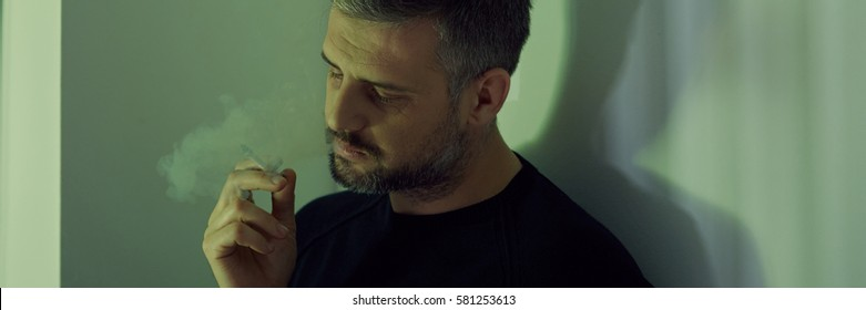 Depressed man with cigarette having midlife crisis