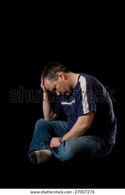 Depressed man on black background