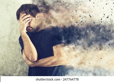 Depressed Man with Problems holding hand over his Face and Crying, occupied by Mind Blowing Thoughts