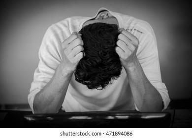 Depressed man sitting,Young handsome thinking,Headache
