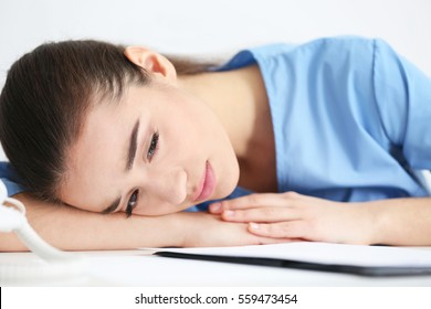 Depressed medical worker in her office, closeup