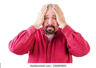 Depressed middle aged man with goatee beard and head in hands on white