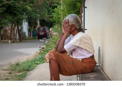 a depressed old Indian poor lady,feeling dejected