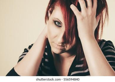 Depressed sad woman holding her head worring