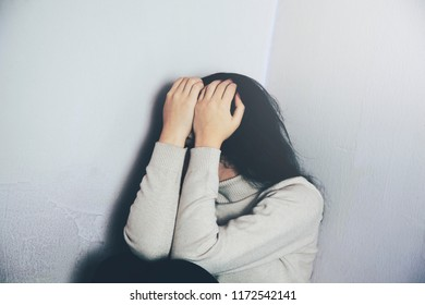 Depressed and sad young woman