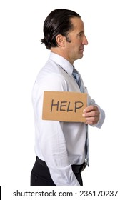 depressed senior Hispanic businessman holding cardboard help sign in overwork , overwhelmed, working under pressure and stress and work exploitation concept