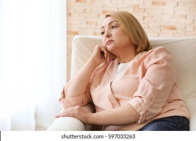 Depressed senior woman at home