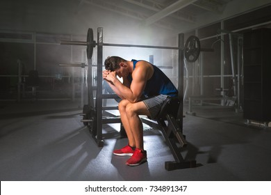 The depressed sportsman sit in the sport center