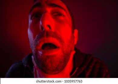 Depressed stressed man strangling himself. Close up headshot portrait of man chokes