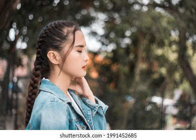 A depressed teenage asian girl after being heartbroken, bullied or ostracized.