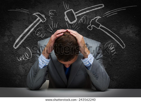 Depressed tired businessman with hands on head