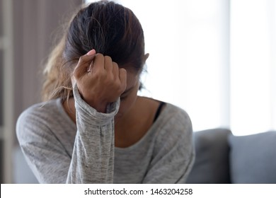 Depressed upset young woman feeling hurt sad stressed troubled with unwanted pregnancy, regret mistake abortion, having headache or drug addiction, suffer from grief dramatic bad problem concept