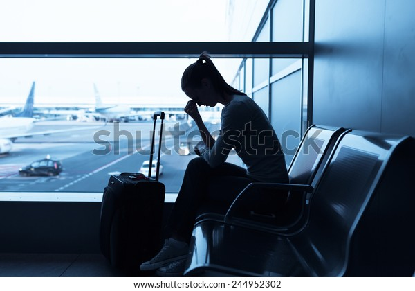 Depressed woman in the airport