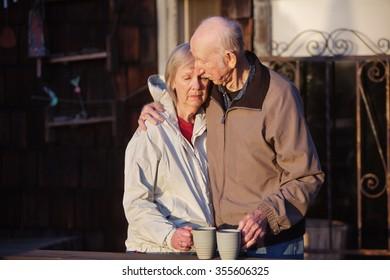 Depressed woman being held by senior man