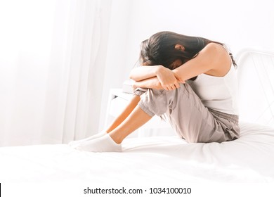 Depressed woman crying on her bed