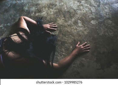 Depressed woman, domestic and rape violence,beaten and raped sitting on the room