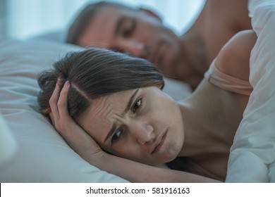 The depressed woman lie near the man