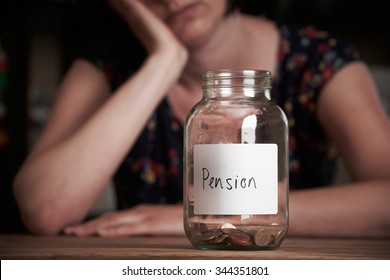 Depressed Woman Looking At Empty Jar Labelled Pension